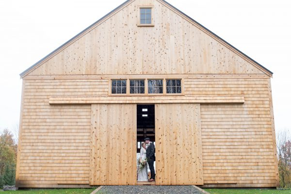 Bride and groom in barn doorway