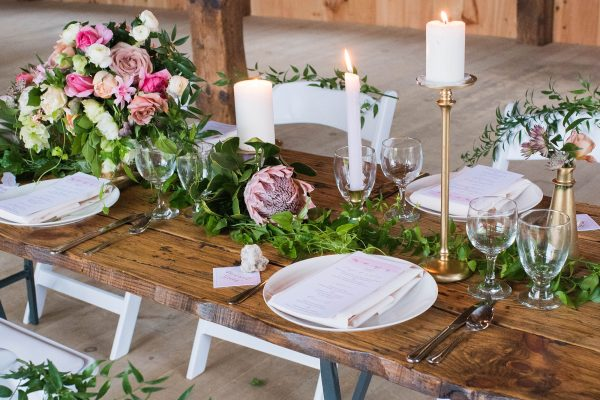 Rustic wedding table setting in barn
