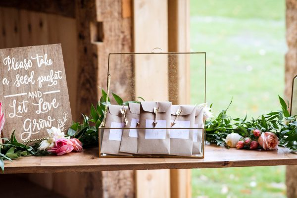 Wedding guest favor table in rustic barn