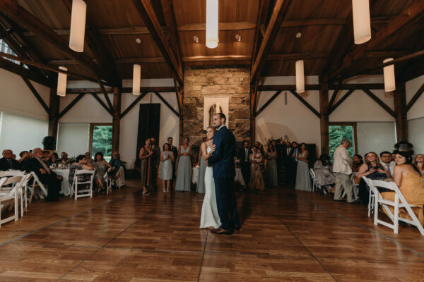 Bride and groom dancing in great room