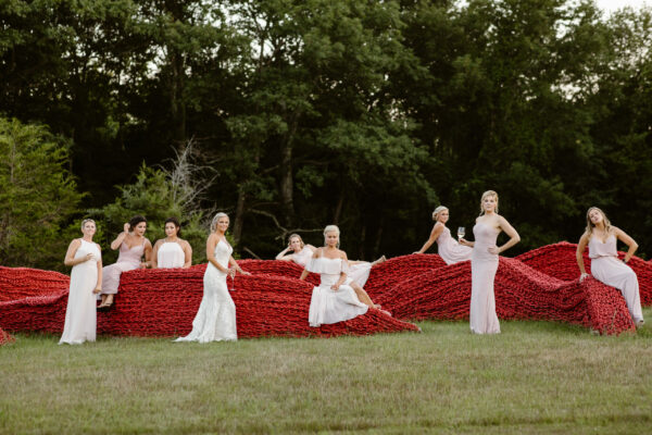 Bride and bridesmaids on Orly Genger sculpture