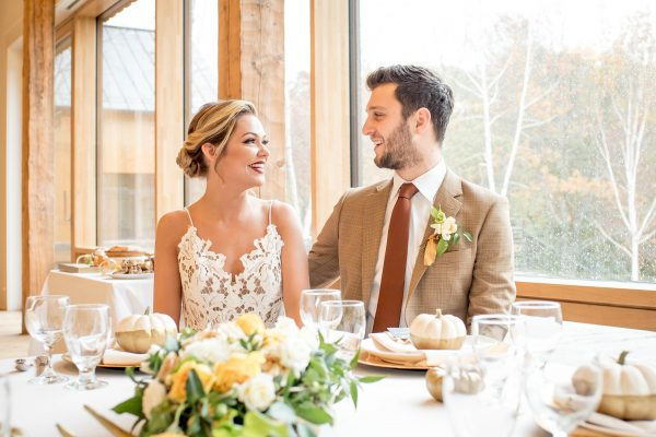 Bride and groom at rustic wedding table