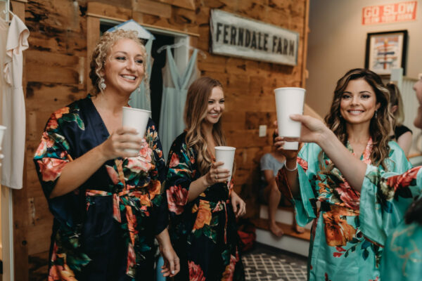 Bridesmaids in cabin celebrating
